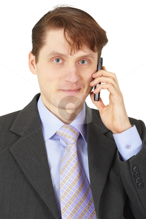 Man in business suit talking on phone stock photo, Man in business suit talking on the phone by Alexey Romanov