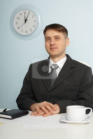 Young chief sitting on workplace stock photo, The young chief sitting in the office workplace by Alexey Romanov