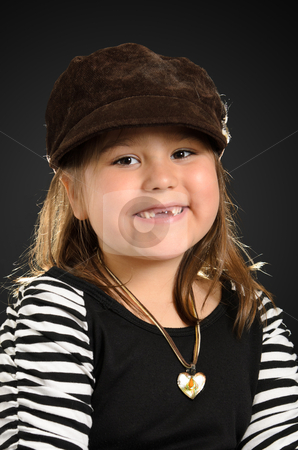 Kindergarten Child stock photo, Portrait of a kindergarten girl smiling and wearing stylish clothes, shot with a backlight. by Richard Nelson
