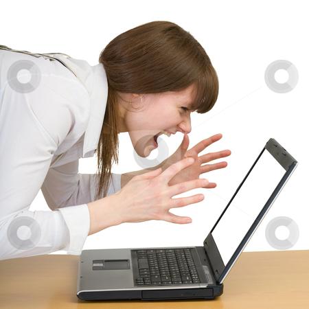 Girl emotionally shouts at the laptop stock photo, Young girl emotionally shouts at the laptop by Alexey Romanov