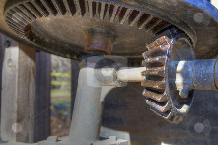 Big gears stock photo, Subtle high dynamic range image of a bevel gear mechanism by bobkeenan