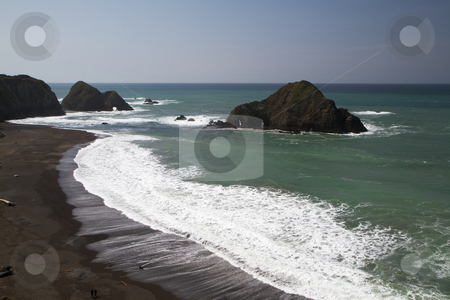 Coastal Rocks and Beach stock photo, California Coastal Rocks and Beach on a blue sky day by bobkeenan