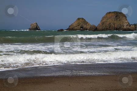 Coastal Waves stock photo, California Coastal Waves on a beach with a view of Large Rocks by bobkeenan