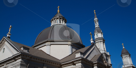 Five Crosses stock photo, Five Gold Crosses of Cathedral with deep blue sky by bobkeenan