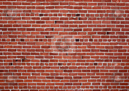 Old red brick wall stock photo, Different shades of ready and a changing pattern red brick wall by bobkeenan