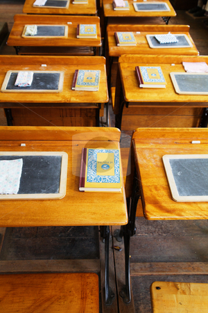Rows of old school desks stock photo, Rows of  wood and metal desks at a an old school house in Sacramento with slates and books by bobkeenan
