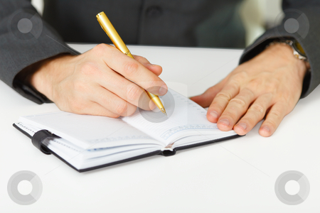 Takes notes in organizer stock photo, Close-up - man takes notes in the organizer by Alexey Romanov