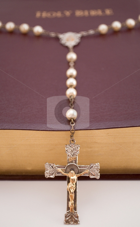 Close up of Rosary laying on Bible stock photo, Close up, low angle shoot of Rosary laying over Holy Bible, by Michael T