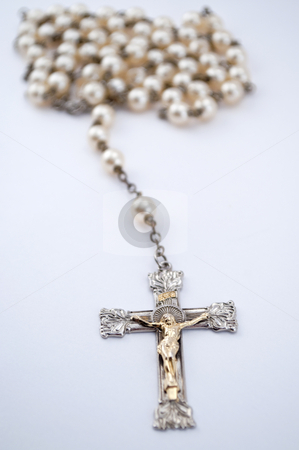 Isolated Rosary With Blurred out Beads stock photo, Isolated rosary with beads blurred out in the back ground by Michael T