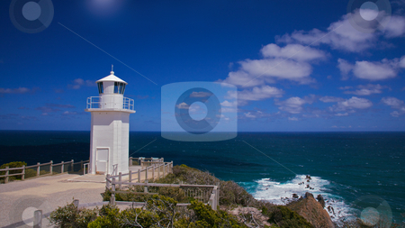 Lighthouse stock photo, Lighthouse over looking the sea view, warning to ships carring cargo by Vividrange