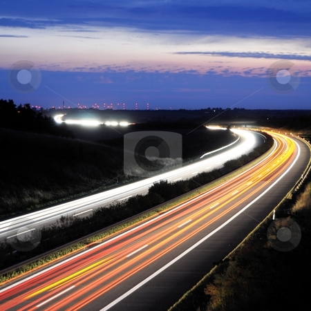 Night traffic motion stock photo, night traffic motion blur on highway showing car or transportation concept by Gunnar Pippel
