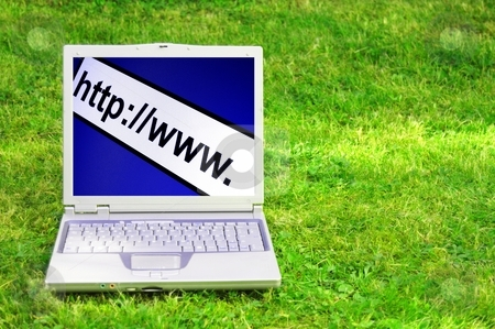 Internet concept stock photo, internet www or online concept with laptop in green grass by Gunnar Pippel