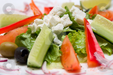 Close-up of Appetizing salad stock photo, Close-up of Appetizing salad  in a plate on white background. by olinchuk