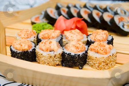 Sushi on wood plate stock photo, Set of sushi on wood plate by olinchuk