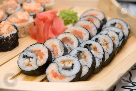 Sushi on wood plate stock photo, Set of sushi on wood plate. by olinchuk