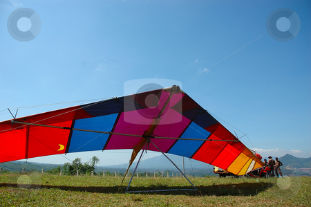 Para glide stock photo, isolated para glide landing on the ground by Bayu Harsa