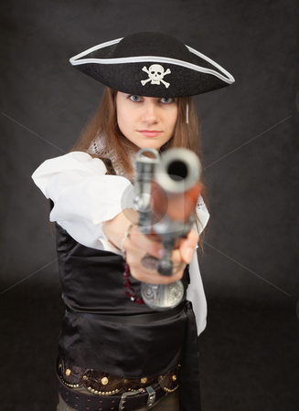Woman - pirate aims in us from an ancient pistol stock photo, The woman - the pirate aims in us from an ancient pistol by Alexey Romanov