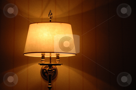 Room lamp stock photo, a room decorative lamp casting light and shadows on a wall by Bayu Harsa