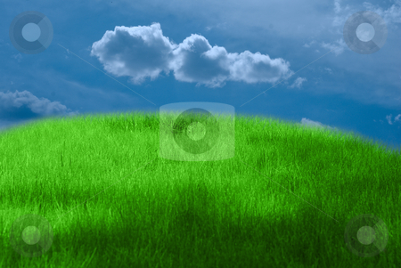 Outdoor stock photo, Green grass, blue dramatic sky and white clouds by olinchuk