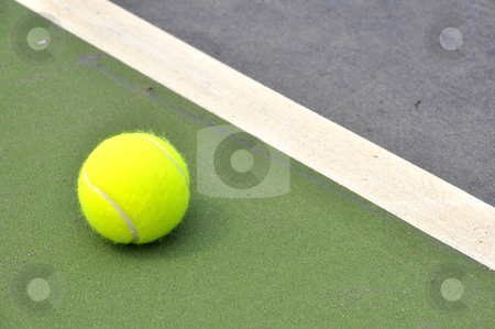Tennis bal stock photo, Tennis ball on a tennis court by phanlop88