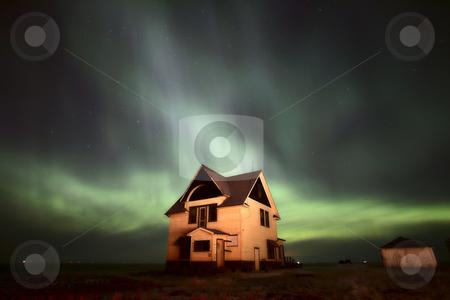 Northern Lights over Saskatchewan farmhouse stock photo, Northern Lights over Saskatchewan farmhouse by Mark Duffy