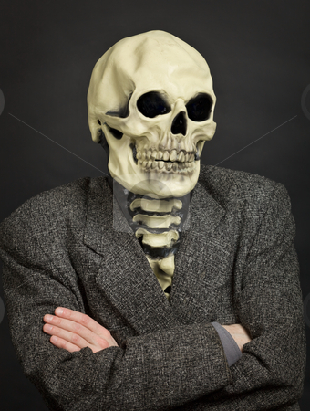 Portrait of person in skeleton mask stock photo, Portrait of the person in a skeleton mask against a dark background by Alexey Romanov