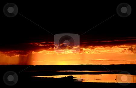 Rain approaching Chaplin Lake at sunset stock photo, Rain approaching Chaplin Lake at sunset by Mark Duffy