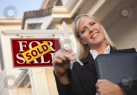Real Estate Agent with Keys in Front of Sold Sign and House stock photo, Female Real Estate Agent with Keys in Front of Sold Sign and Beautiful House. by Andy Dean