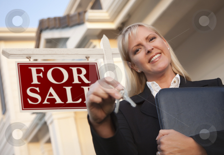 Real Estate Agent with Keys in Front of Sign and House stock photo, Female Real Estate Agent with Keys in Front of Sign and Beautiful House. by Andy Dean