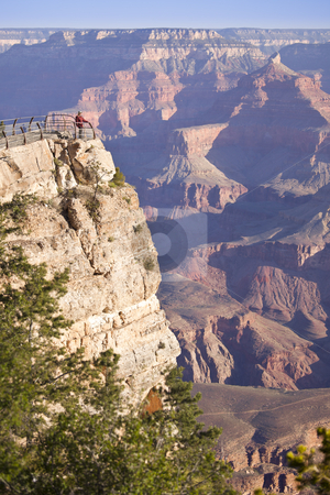 Woman Enjoys the Beautiful Grand Canyon Landscape View stock photo, Woman in Red Shirt Enjoys the Beautiful Grand Canyon Landscape from the View Point. by Andy Dean