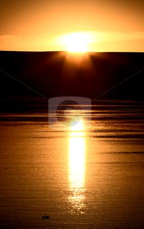 Sunset reflected off Eyebrow Lake stock photo, Sunset reflected off Eyebrow Lake by Mark Duffy