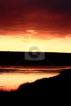 Sun set behind hills of Eyebrow Lake stock photo, Sun set behind hills of Eyebrow Lake by Mark Duffy