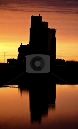 Eyebrow gain elevator reflected off water after sunset stock photo, Eyebrow gain elevator reflected off water after sunset by Mark Duffy
