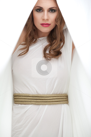 Portrait of young woman in greek inspired white dress, smiling stock photo, a studio portrait of a beautiful young woman, wearing a long, white, ancient greek inspired dress, holding a piece of material in a cocoon shape, from above her head, smiling. by dan comaniciu