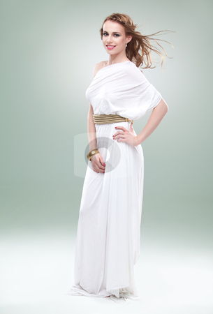 Portrait of young woman in greek inspired white dress, smiling,  stock photo, a studio portrait of a beautiful young woman, wearing a long, white, ancient greek inspired dress, smiling, with wind blowing in her hair. by dan comaniciu