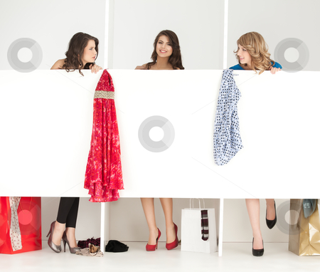 Girls looking clothes in wordrobe stock photo, young women trying clothes shop wordrobe by dan comaniciu