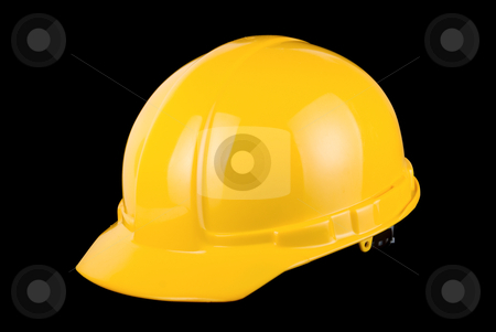 Yellow helmet isolated  stock photo, Yellow helmet isolated on a black background by olinchuk