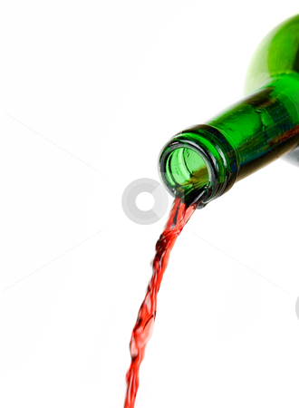 Pouring wine stock photo, Wine being poured from a bottle isolated on white background by olinchuk