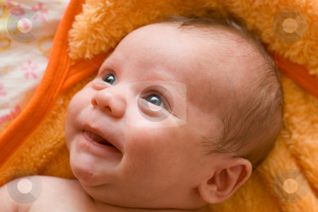 Laughing baby boy  stock photo, Portrait of laughing baby boy lying on the bed by olinchuk