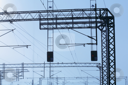Railroad powerlines stock photo, Railroad powerline silhouettes against hazy sky. by Stocksnapper