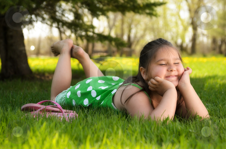 Spring Portrait stock photo, A young girl laying in the grass relaxing and enjoying the spring weather. by Richard Nelson