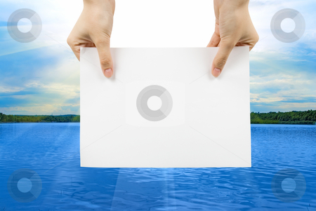 Summer stock photo, Hand with white paper on a summer lake background by olinchuk
