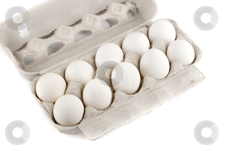 Eggs stock photo, Eggs at the box isolated on a white background by olinchuk