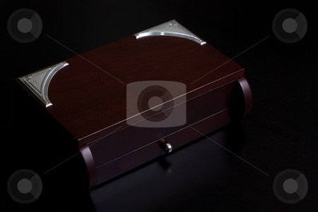 Box stock photo, Brown wooden box on a dark background by olinchuk