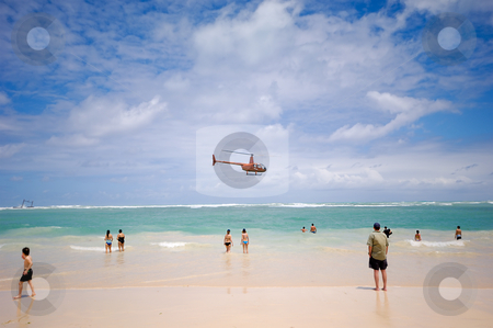 Helicopter near beach stock photo, A helicopter is flying very near the beach. Dominican Republic, Punta Cana. by Lars Christensen