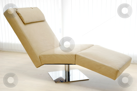 Trendy sofa stock photo, A very trendy leather sofa in a room. by Lars Christensen