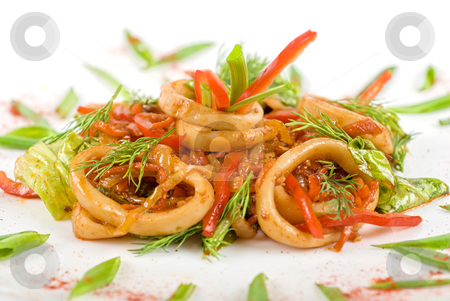 Seafood salad stock photo, Seafood salad with squid and vegetables closeup by olinchuk