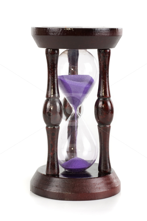 Hourglass stock photo, hourglass closeup isolated on a white background by olinchuk