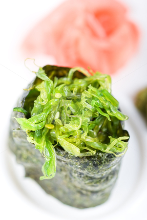 Maki sushi stock photo, Japanese fresh maki sushi with green seaweed by olinchuk
