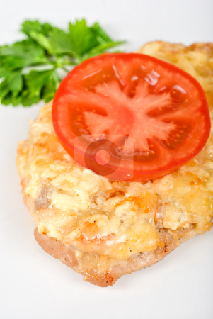 Roasted pork steak stock photo, Roasted pork steak baked with cheese and tomato by olinchuk